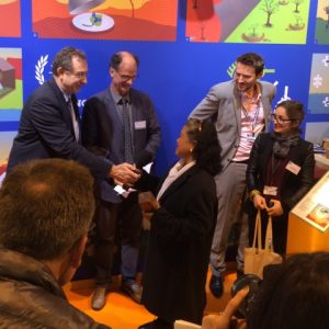 Dr. Llemit receiving the best project award from the AFD and CIRAD officials during the awarding ceremony at the AFD-CIRAD Stand of the International Agricultural Show in Paris, France.